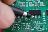 Test repair job on electronic printed circuit board — Stock Photo