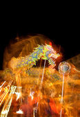 Motion blur chinese traditional dragon dance perform in night — Stock Photo