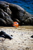 A beachball next to the rock on a summer holiday in Sarti, Greec — Stock Photo