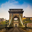 The Szechenyi Chain Bridge is a beautiful, decorative suspension bridge that spans the River Danube of Budapest, the capital city of Hungary. — Foto de Stock