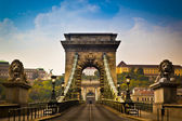 The Szechenyi Chain Bridge is a beautiful, decorative suspension bridge that spans the River Danube of Budapest, the capital city of Hungary. — Stock Photo