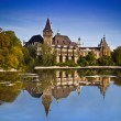Historical building in Budapest - Vajdahunyad Castle with lake over blue sky in main City Park. This is similar castle like in Transilvania — Stock Photo #13924791