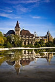 Historical building in Budapest - Vajdahunyad Castle with lake over the blue sky in main City Park. This is the similar castle like in Transilvania — Stock Photo