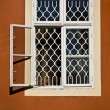 Royalty-Free Stock Photo: White vintage wooden window on the orange wall