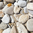 Decorative stone, gravel, pebbles as a background, texture - Stock Photo