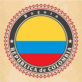 Vintage label cards of Colombia flag. — Stok Vektör