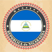 Vintage label cards of Nicaragua flag. — Stock vektor