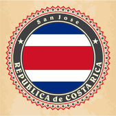 Vintage label cards of Costa Rica flag. — Vettoriale Stock