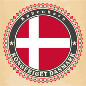 Vintage label cards of Denmark flag — Vector de stock