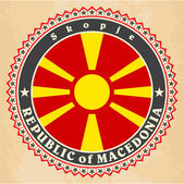 Vintage label cards of  Macedonia flag — Stock Vector