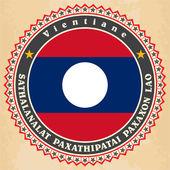 Laos bayrağı Vintage etiket kartları. — Stok Vektör