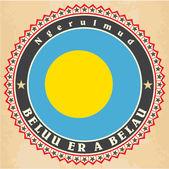 Carte d'epoca etichetta della bandiera di palau. — Vettoriale Stock