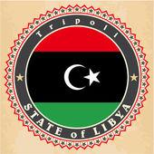 Vintage label cards of Libya flag. — Stock Vector