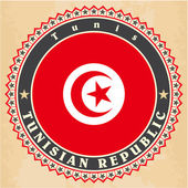 Vintage label cards of Tunisia flag. — Stock Vector