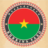 Vintage label cards of Burkina Faso flag.  — Stock Vector
