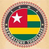 Vintage label cards of Togo flag.  — Stock Vector