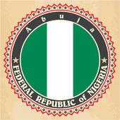 Vintage label cards of Nigeria flag.  — Stock Vector