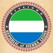 Vintage label cards of Sierra Leone flag.  — Stock Vector