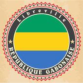 Vintage label cards of Gabon flag. — Stock Vector