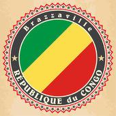 Carte etichetta d'epoca della repubblica la bandiera del congo. — Vettoriale Stock