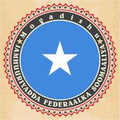 Carte d'epoca etichetta della bandiera della somalia. — Vettoriale Stock