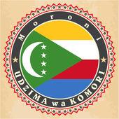 Carte d'epoca etichetta di bandiera Comore. — Vettoriale Stock