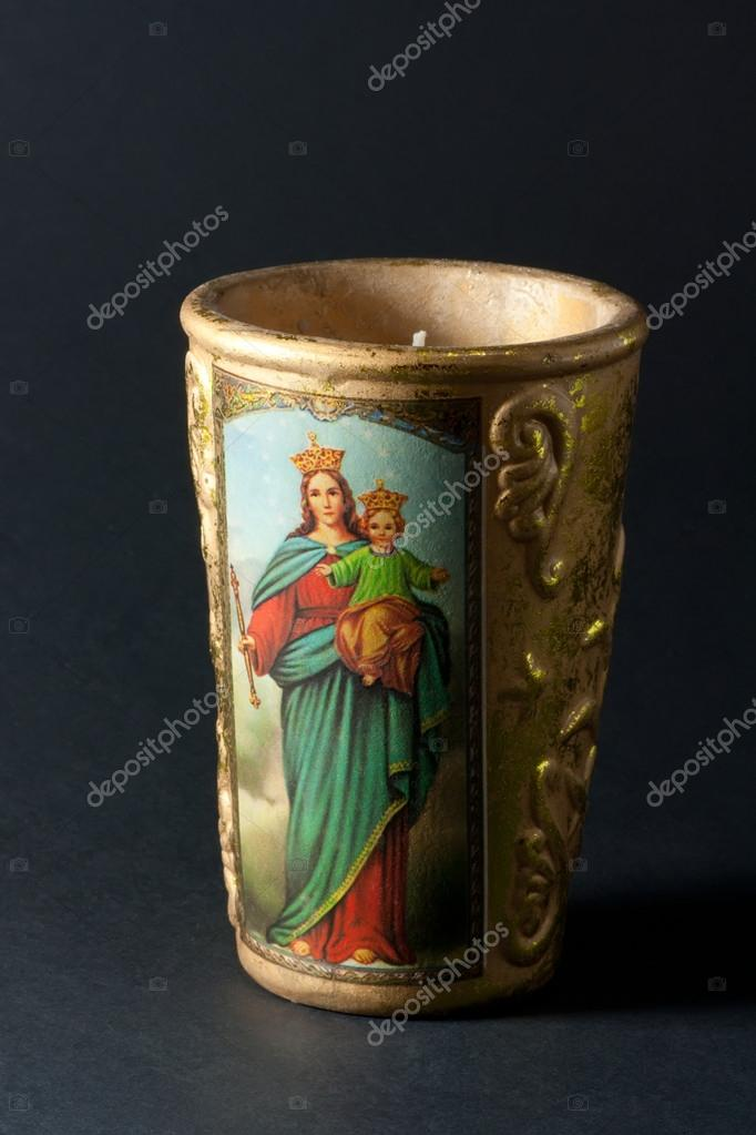 Virgin Mary and Jesus Candle.  Black marble background. Close up. — Stock Photo #13378991