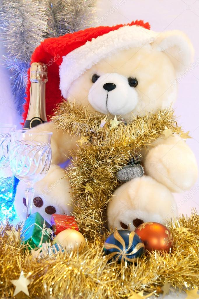 New Year's bear with the New Year's champagne in the background — Stock Photo #14607983