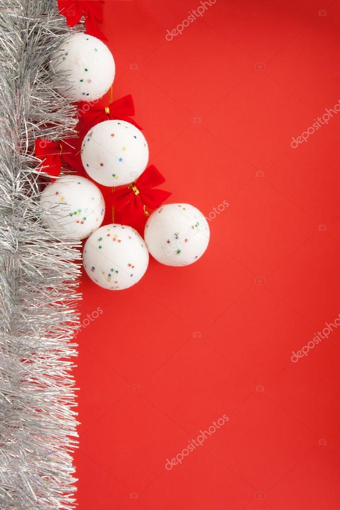 Christmas decorations. White balls on a red background, with copy paste space. — Stockfoto #14945447