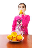 Girl and juicer — Stock Photo