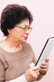 Old Woman and PC Tablet — Stock Photo