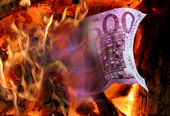Fire and money — Stockfoto