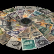 Stock Photo: Compass and banknotes of many Countries