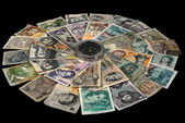 Compass and banknotes of many Countries — Stock Photo