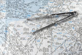 Aeronautical navigation chart and a pair of compasses — Stock Photo