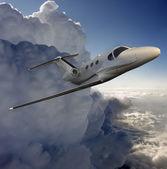 Executive in flight near a storm — Stock Photo