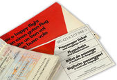 Airline ticket and open passport — Stock Photo