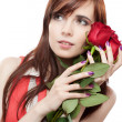 Female with red roses on white background — Stok fotoğraf