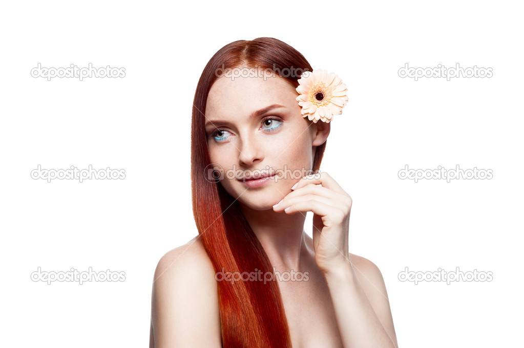 Young red-haired female with gerbrera flower in hair — Stock Photo #13385294