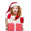 Young red-haired surprised girl holding christmas gift — Stock Photo #13704805