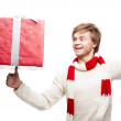 Young smiling man holding christmas gift — Stock Photo #13887233