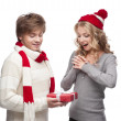 Young couple presenting christmas gift — Stock Photo