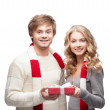 Young happy couple holding chritsmas gift — Stock Photo #14027500