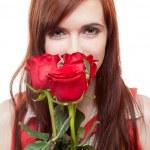 Girl holding red roses — Stock Photo #14477029