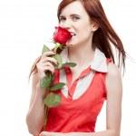 Girl holding red rose — Stock Photo