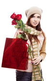 Girl holding red shopping bag — Stock Photo
