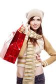 Girl holding red shopping bag — Stock Photo