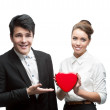 Young happy business holding red Valentine — Stock Photo