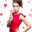 Young cheerful woman holding lollipop — Foto de Stock