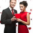 Stock Photo: Young couple holding red heart